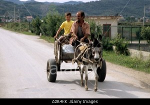 Father and son on their way to market near Tirana Albania